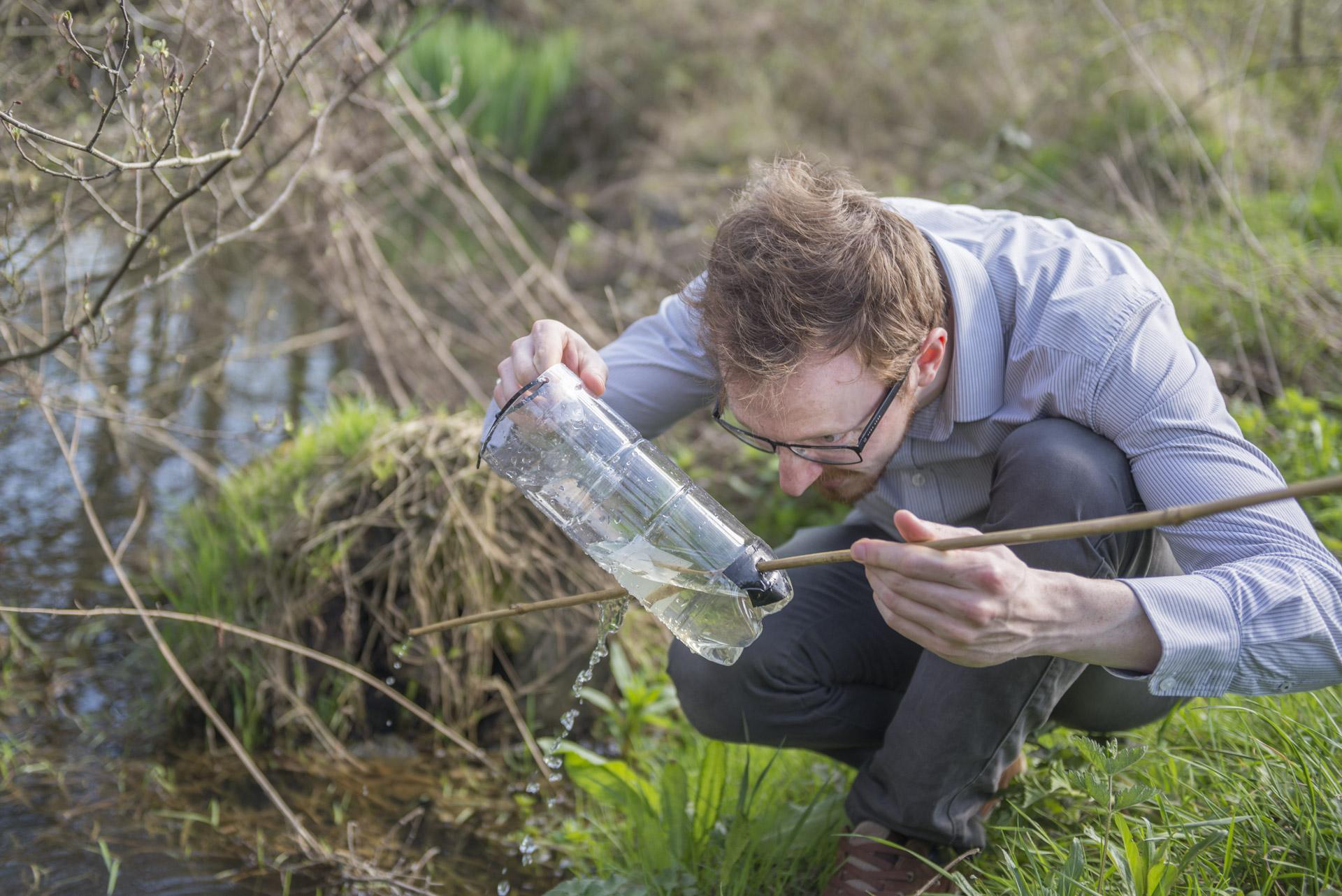 Matt Wall, Senior Ecologist, checking for aquatic life.