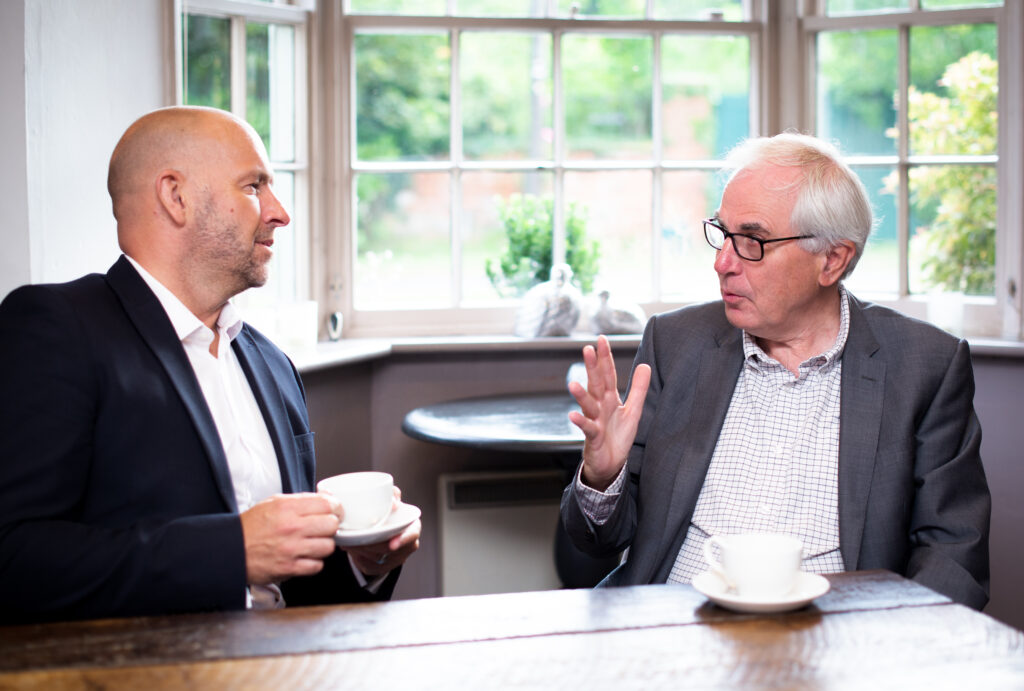 Happy Lawyer and Client having coffee